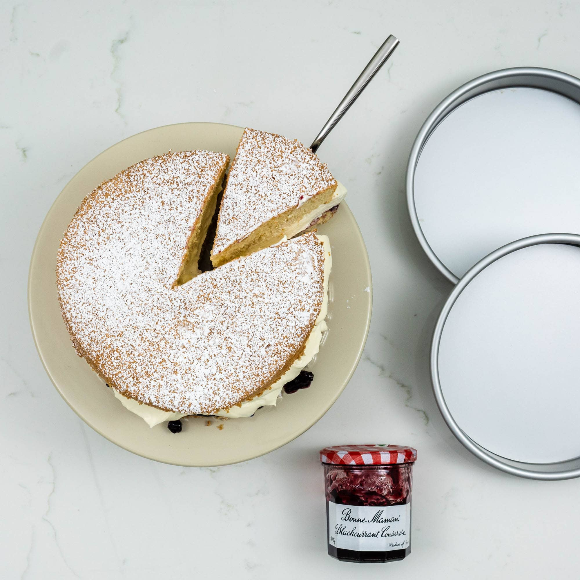 victoria sponge cake with slice cut out