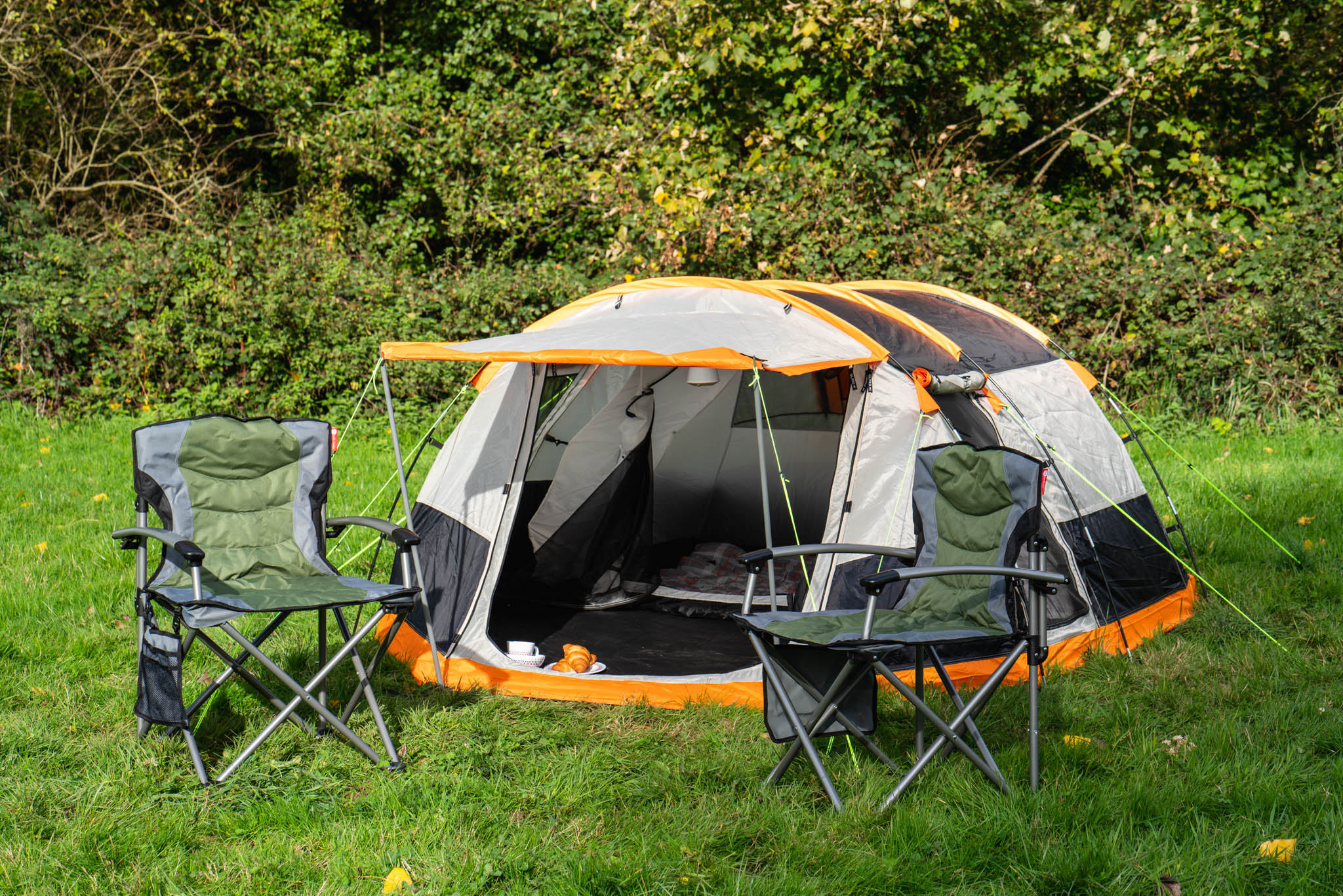 tent with two camping chairs