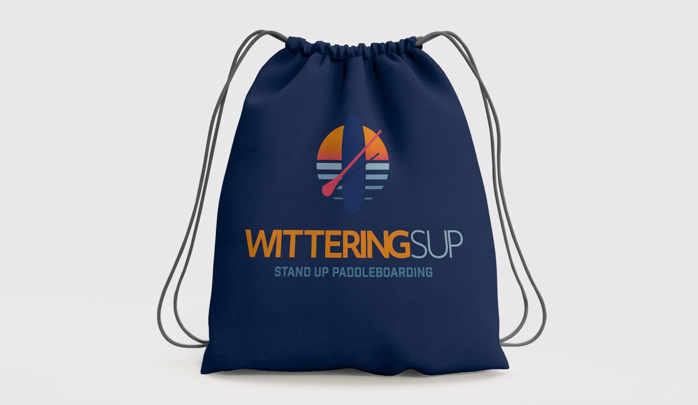 branded merchandise dark blue drawstring bag with wittering logo on