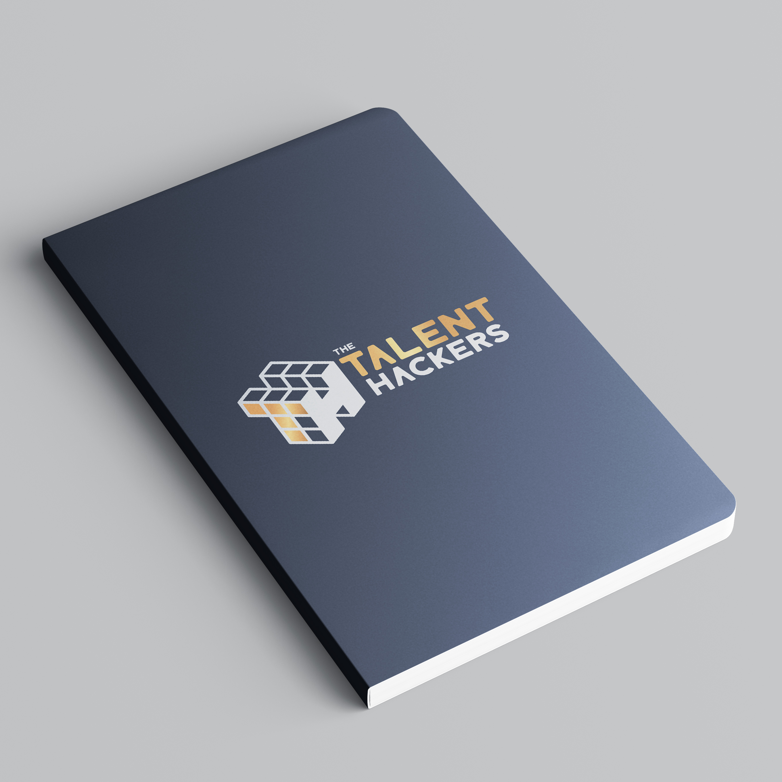 talent hackers logo redeign on a dark blue notebook
