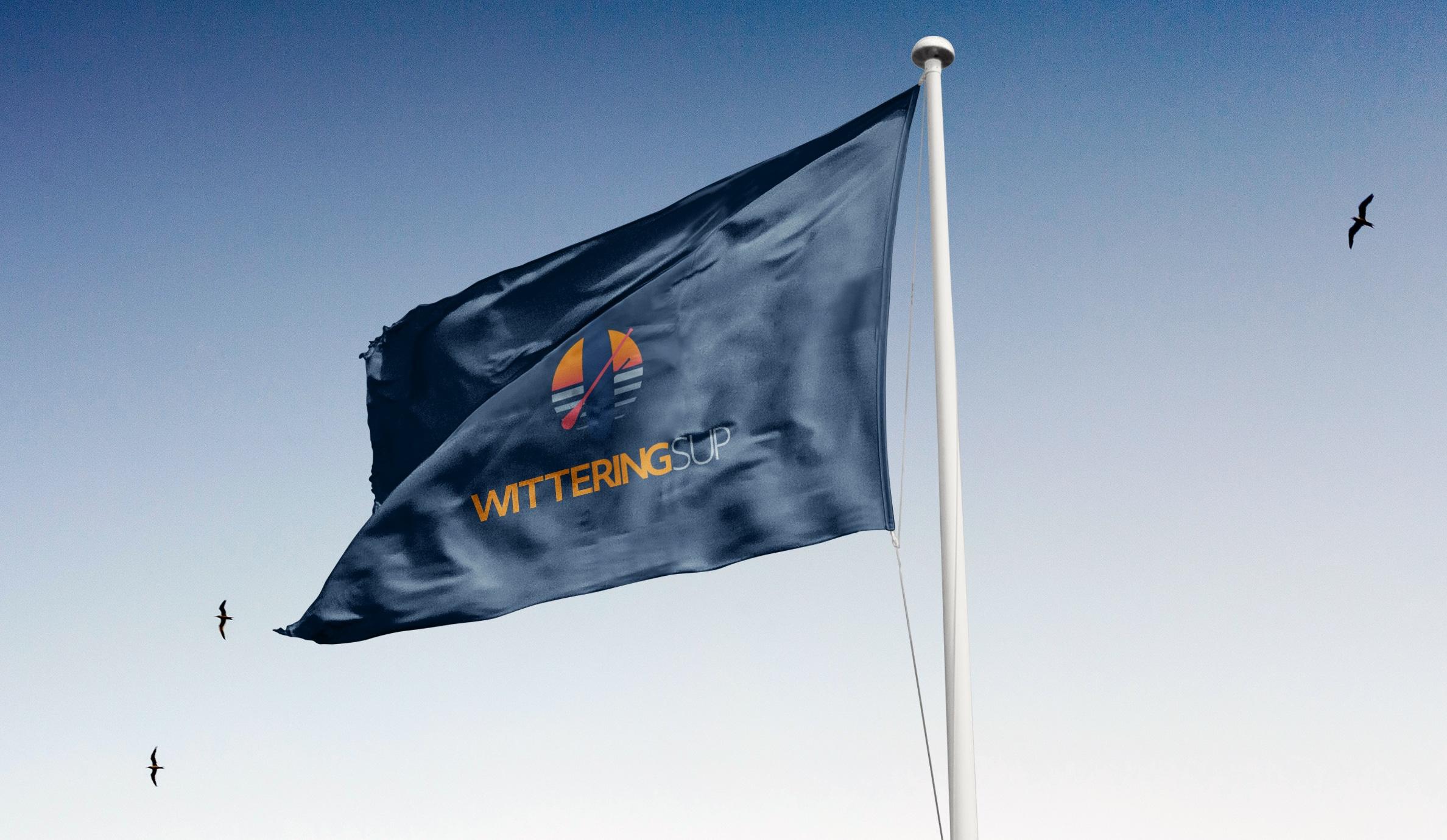 wittering sup branded merchandise dark blue flag with logo