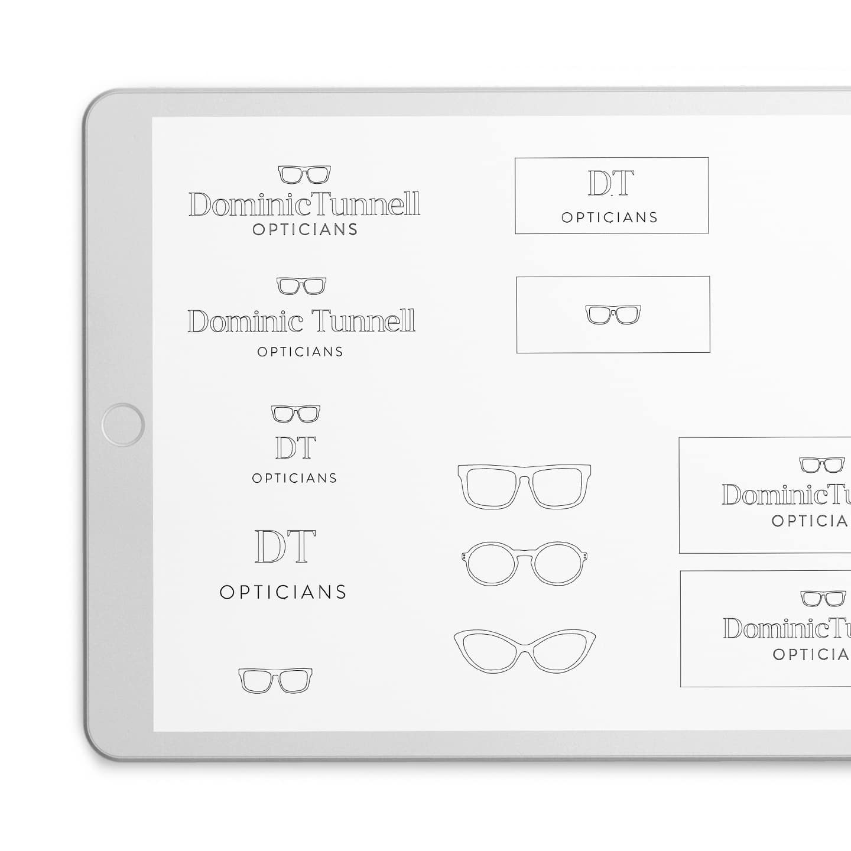 dominic tunnell logo ideas on a grey ipad