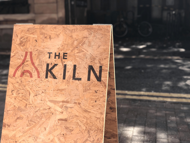 kiln board with logo on it